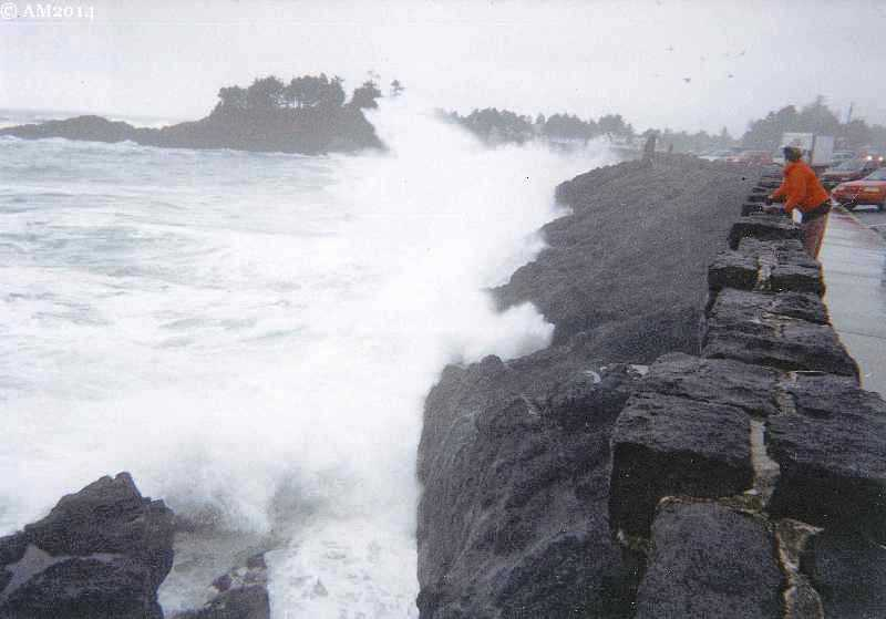 A giant wave crashes against the Highway 101 seawall in front of Depoe Bay