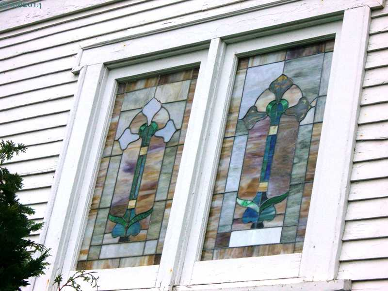 A close up view of two stained glass windows in the United Methodist church, Amity, Oregon.