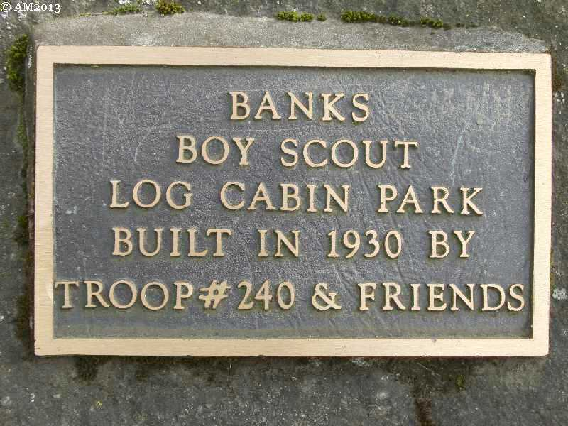 This bronze plaque notes that the boy scouts built this log cabin in 1930