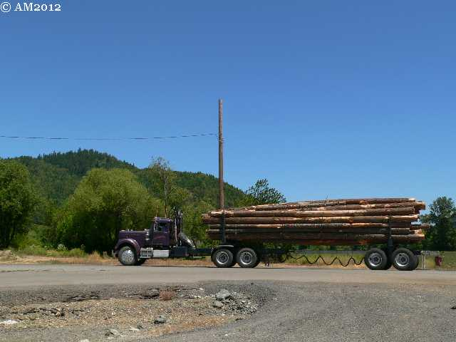 A loaded logging truck waits his turn in Glendale, Oregon.