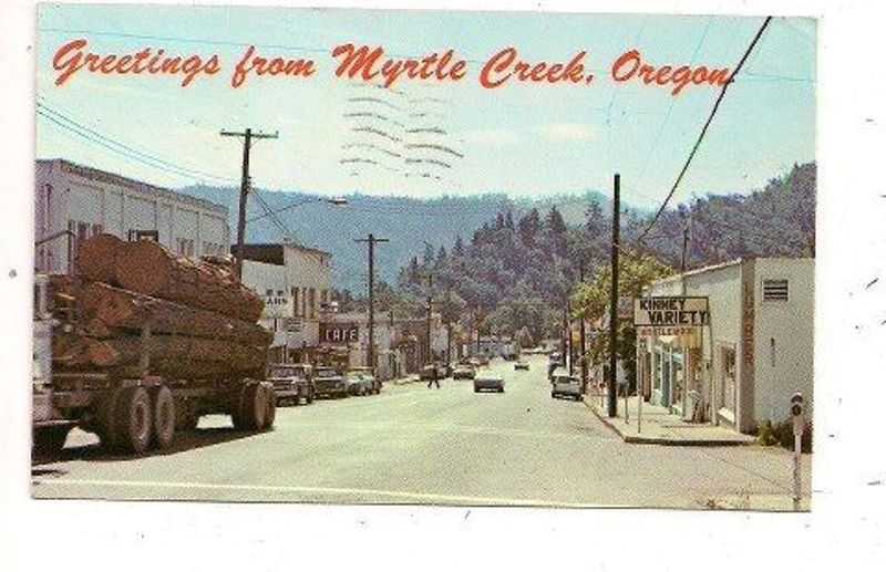 From the 1950's: a logging truck on Main Street, Myrtle Creek, Oregon.